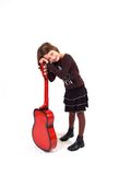 Young Girl With Red Guitar Stock Photography