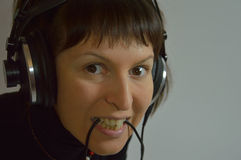 A young girl, a woman with headphones and a microp Stock Images