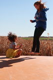Young girl and woman jumping Stock Photo