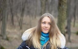Young girl in the wood. The young girl on a background of an autumn wood Royalty Free Stock Image
