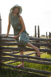 Young girl on wood fence Stock Photography
