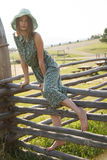 Young girl on wood fence Royalty Free Stock Images