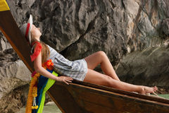 Young girl in a wooden boat Stock Image