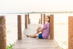 young girl on a wooden bridge Stock Photo