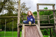 Young girl and wooden teeter board Royalty Free Stock Images