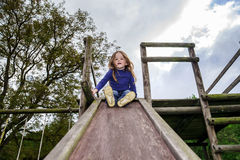Young girl and wooden teeter board Stock Photography
