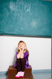 Young girl with word hello on chalkboard Royalty Free Stock Photo