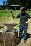 Young girl working as a blacksmith Royalty Free Stock Photography