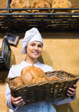 Young girl working in bakery with bread and different pastry Royalty Free Stock Photos