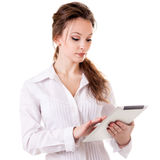 Young girl working at a digital tablet isolated on white Royalty Free Stock Image