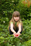 Young girl working in the garden Royalty Free Stock Images