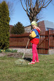 Young girl working in the garden. Royalty Free Stock Image