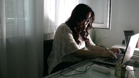 Young Girl Working at Home with Computer Royalty Free Stock Photography