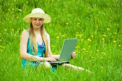 Young girl working on laptop Royalty Free Stock Image