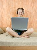 Young girl working with laptop Stock Image