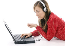 young girl working on laptop and listening music Stock Image