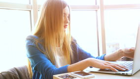 A young girl working in the laptop looks into the monitor and upset. A young attractive girl working behind the laptop looks into the monitor and upset stock video
