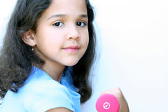 Young Girl Working Out. Young girl on white background working out (overexposed Royalty Free Stock Images