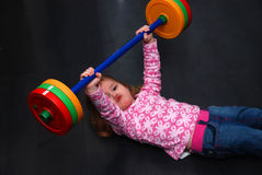 Young Girl Working Out. A young girl is working out Stock Images