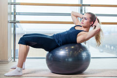 Young girl working out at the gym with a ball Royalty Free Stock Image