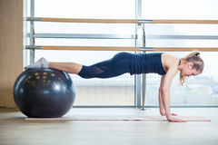 Young girl working out at the gym with a ball Royalty Free Stock Images