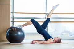 Young girl working out at the gym with a ball Royalty Free Stock Photography