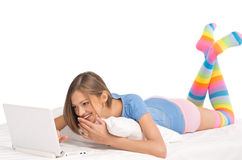Young Girl Working With Laptop At Home Stock Photo
