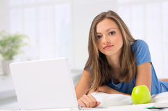 Young Girl Working With Laptop At Home Stock Photos
