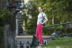 Young  girl after the workout standing outdoors. Stock Images