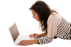 Young girl works with the laptop Stock Image