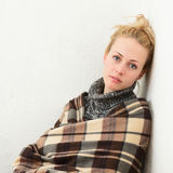 Young girl wrapped in a blanket Stock Images