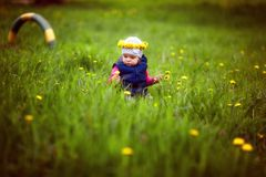 Young girl with wreath on lawn royalty free stock photos