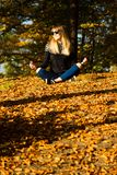 Young girl in a wreath of leaves. The girl in the park. Autumn. stock photography