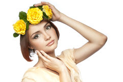 A young girl with wreath of roses Royalty Free Stock Photos
