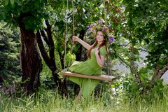Young girl with a wreath of wild flowers Royalty Free Stock Photography