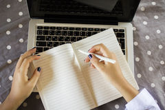 Young girl writes in a diary Royalty Free Stock Photos