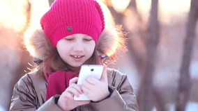 Young girl writes on the phone stock video