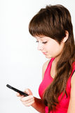 A young girl writes sms Stock Images
