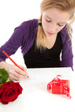 Young girl is writing be my valentine Stock Photography
