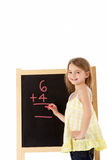 Young Girl Writing On Blackboard Royalty Free Stock Image