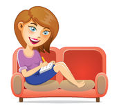 Young Girl Writing A Book On Sofa Royalty Free Stock Image