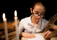 Young girl writing with feather Royalty Free Stock Images