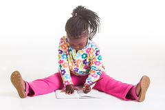 A young girl writing in her diary. Royalty Free Stock Photo