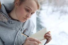 Young girl writing in her journal. Royalty Free Stock Image