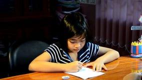 Young girl writing homework. stock footage