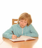 Girl with homework Stock Image