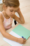 Young girl writing in a notebook Royalty Free Stock Photo