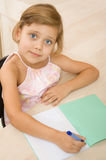 Young girl writing in a notebook Stock Photo