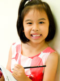 Young Girl writing and reading Stock Photography
