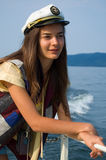 Young girl on a yacht Stock Photo